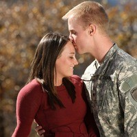 Man in Military Uniform Kissing His Wife's Head
