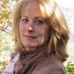 Woman in Brown Jacket Smiling