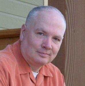Man in Orange Shirt Smiling