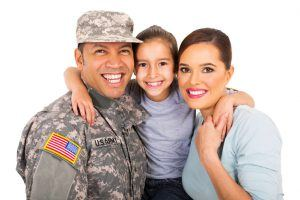 portrait of beautiful young military family on white background
